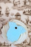 Blue Onesie on Cup Cake Stock Images