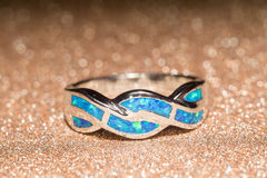 Blue Opal Ring. Fashion ring decorated with blue fire opal stones stock photos