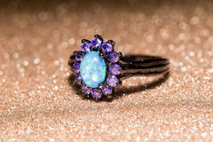 Blue Opal Ring. Fashion ring decorated with blue fire opal stones royalty free stock photos