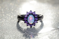 Blue Opal Ring. Fashion ring decorated with blue fire opal stones royalty free stock images