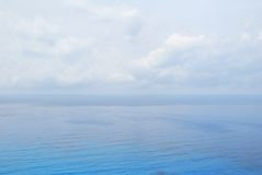 Blue open sea water and sky Stock Images
