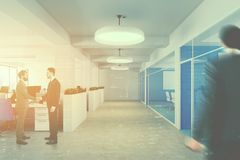Blue open space office interior, people Royalty Free Stock Image