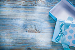 Blue opened gift box on wooden board copy space holidays concept Royalty Free Stock Photos