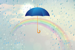 Blue opened umbrella with rain and rainbow Stock Photos