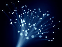 Blue optic fibers Stock Images