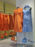 Blue and orange. Colorfull dresses stock photo