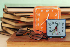 Alarm clock and books. Royalty Free Stock Photography