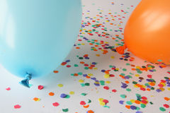 Blue and orange balloons with confetti. Blue and orange balloons on a white background with confetti - Copy space in balloon Royalty Free Stock Image