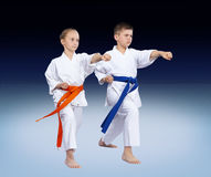 With blue and orange belt athletes are beating punch arm Stock Photo