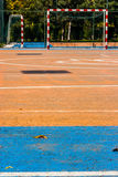 Blue and orange cement soccer yard in the park. Blue and orange cement soccer yard in the park afternoon stock photography