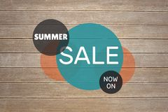 Blue and orange circular sale graphic on decking Royalty Free Stock Photos