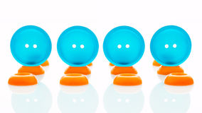 Blue and orange clothes buttons Stock Photography