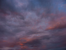 Blue and orange clouds. In sunrise or sunset royalty free stock photo