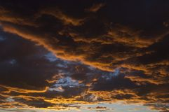 Blue orange cloudscape at sunset Royalty Free Stock Images