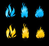 Blue and orange glowing flames on black background Royalty Free Stock Images