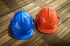 Blue, orange hard safety helmet construction hat for safety proj Stock Photo