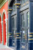 Blue and orange Historic buildings. Historic building facades with orange and blue storefronts Stock Photos