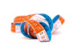 Blue and orange  measuring tape. Blue and orange spiral  measuring tape over white Royalty Free Stock Images