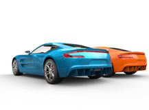 Blue and orange metallic cars Stock Images