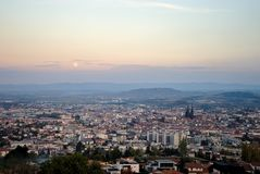 Moonrise over the city of clermont ferrand Stock Photo