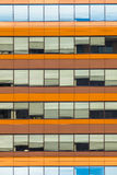 Blue and Orange Office Window Background. Office Windows as a Concept for Bussines Hours and Jobs Royalty Free Stock Photo