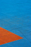 Blue and orange plastic texture playground with trails on it. Blue and orange plastic texture playground with trails on it at noon Stock Photography