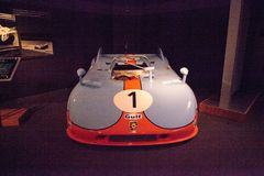 Blue and orange 1971 Porsche 908/3 Prototype. Naples, Florida, USA – May 5, 2018:  Blue and orange 1971 Porsche 908/3 Prototype displayed at The Revs Institute Stock Images
