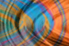 Blue and orange ripples background stock image