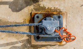 Blue and Orange Ropes on Steel Bollard Stock Photos