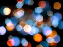 Blue and orange round blurred lights abstract on a black background royalty free stock image