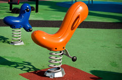 Blue and orange seesaws Stock Image