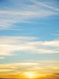 Blue and orange sky. At sunset slightly covered with cirrus clouds Stock Image