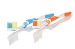 Blue and Orange Toothbrushes Royalty Free Stock Photography
