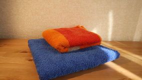 Blue and orange towels stock video