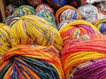 Colorful yarn on sell in shop. Blue, orange and various multicolored wool yarn on sale abstract art background ball bright clew closeup colorful coloured cotton stock photography