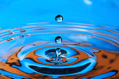 Blue- Orange Water Drop Splashing Royalty Free Stock Photo
