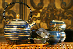Blue oriental teapot with cups Royalty Free Stock Photo