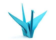 Blue origami bird. Royalty Free Stock Images