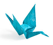 Blue Origami Crane. Folded with textured paper royalty free stock image