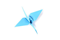 Blue origami crane over white Stock Images