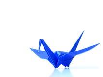 Blue origami crane. A blue origami crane on white background stock photography