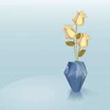 Blue origami vase with yellow roses Royalty Free Stock Photos