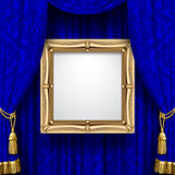 Blue ornamental curtain background with a suspended gold classic Royalty Free Stock Image