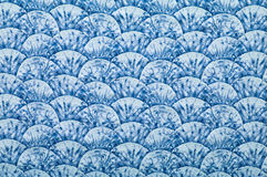 Blue ornated textile. Blue textile with ornaments in form of hills or waves Stock Images