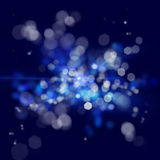 Blue out of focus spotlights. Texture ofout of focus bright lights on a dark background Stock Photography