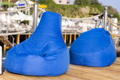 Blue  outdoor lounge sea sunbeds Royalty Free Stock Photo