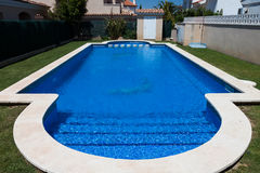 Blue outdoor pool near villa Stock Photos