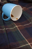 The blue overturned cup Royalty Free Stock Images