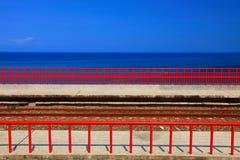 Blue pacific ocean and train rail Stock Photo