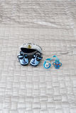 Blue pacifier, sailor hat, baby bootees Stock Image